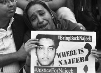 Najeeb mother holding placard in protest