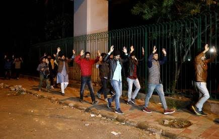students raising up thier hands leaving Jamia