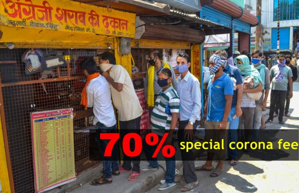 People throng at a wine shop amid corona virus pandemic in India
